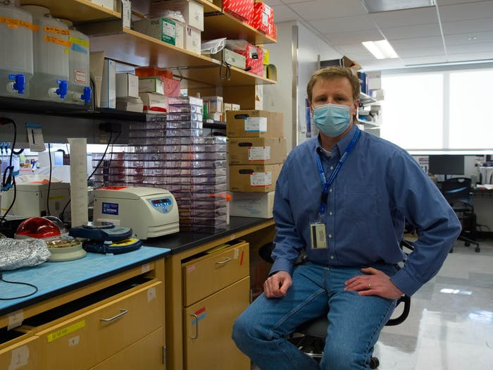 Dr. Mark Heise poses for a portrait in his lab inside the Burnett-Womack building on Monday, Feb. 8, 2021. Heise is a a professor of microbiology, immunology and genetics in the UNC School of Medicine and a collaborator of READDI.