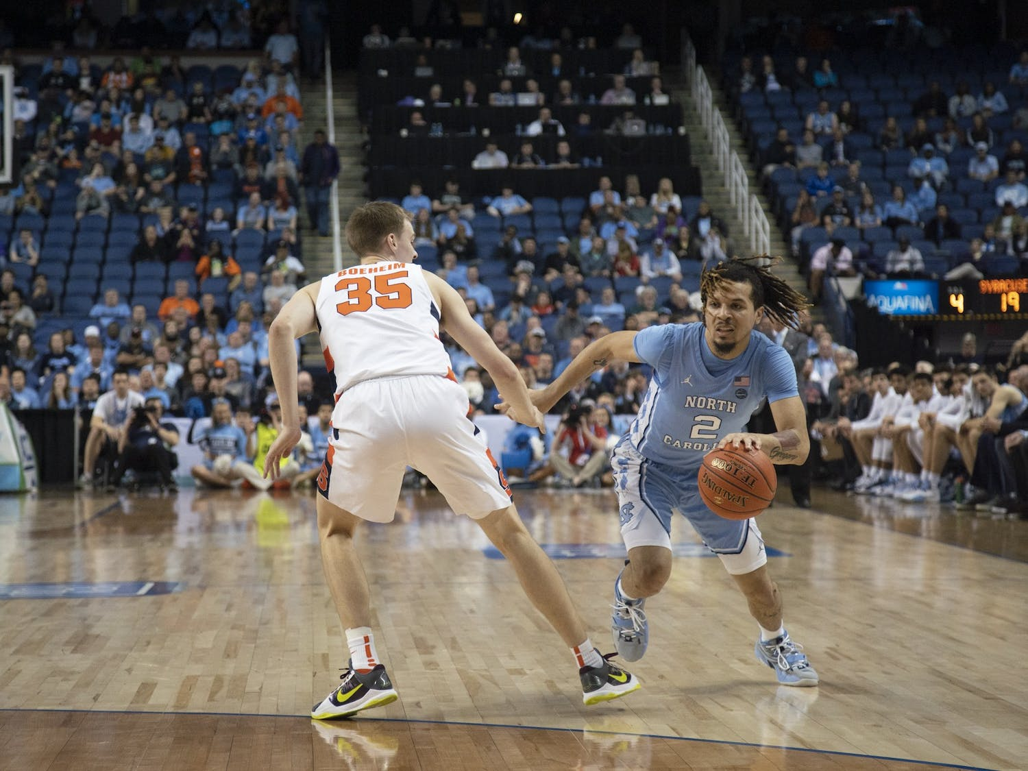 UNC first-year guard Cole Anthony (2) dribbles upcourt against Syracuse in the second round of the 2020 New York Life ACC Tournament at the Greensboro Coliseum, in Greensboro, N.C., on Wednesday, March 11, 2020. UNC lost 81-53.