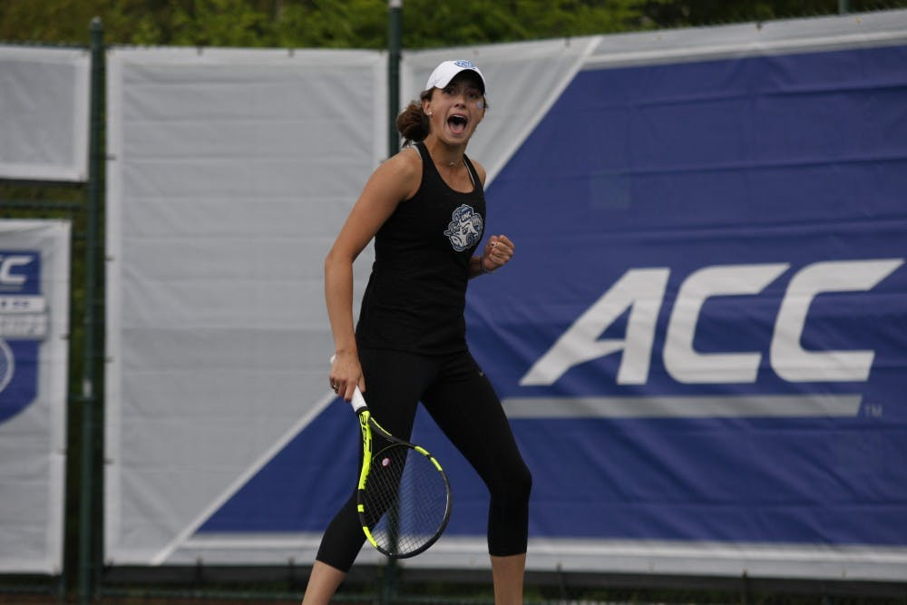 Women's tennis first-year Cameron Morra celebrates after winning both of her singles sets in the semifinals of the ACC Tournament at Cary Indoor Tennis Park on Saturday, April 20, 2019. UNC beat Miami 4-0.