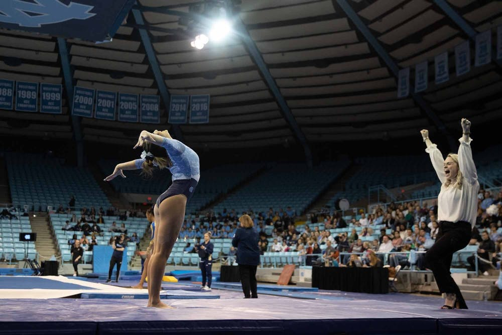 <p>First-year Hannah Nam sticks her landing after performing her balance beam routine during a meet against George Washington in Carmichael Arena on Friday Feb. 28, 2020. The Tar Heels placed first against the Colonials.</p>