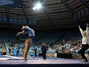First-year Hannah Nam sticks her landing after performing her balance beam routine during a meet against George Washington in Carmichael Arena on Friday Feb. 28, 2020. The Tar Heels placed first against the Colonials.