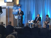 UNC head coach Mack Brown addresses the media at his introductory press conference on the third floor of the Loudermilk Center for Excellence on Nov. 27, 2018. Director of athletics Bubba Cunningham and Chancellor Carol Folt look on beside him.