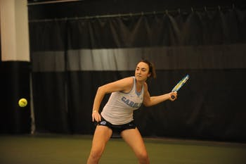 Senior Chloe Ouellet-Pizer prepares to return the ball during a singles match against App State on Tuesday, Feb. 19, 2019. UNC beat App State 7-0.
