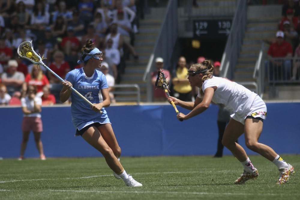<p>UNC midfielder Marie McCool looks for an open teammate to pass to. The North Carolina women's lacrosse team defeated Maryland 13-7 to capture the NCAA championship on May 29, 2016&nbsp;at Talen Energy Stadium in Chester, PA.</p>
