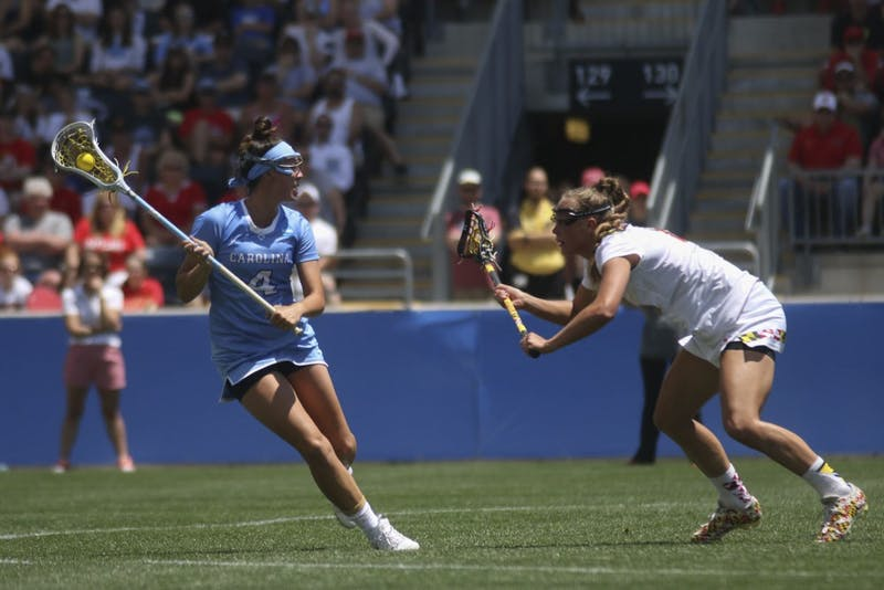 UNC midfielder Marie McCool looks for an open teammate to pass to. The North Carolina women's lacrosse team defeated Maryland 13-7 to capture the NCAA championship on May 29, 2016 at Talen Energy Stadium in Chester, PA.