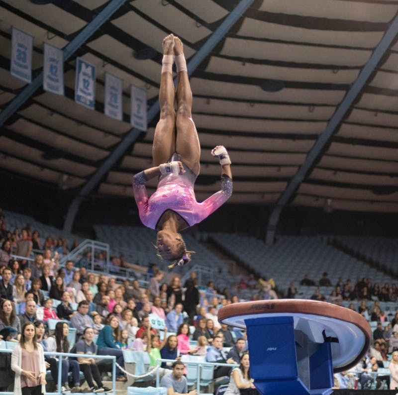Khazia Hislop vaults during home opener and annual Women's Day and Pink Meet against Oklahoma and Ball State on Saturday, Jan. 19, 2019. UNC placed second behind Oklahoma.