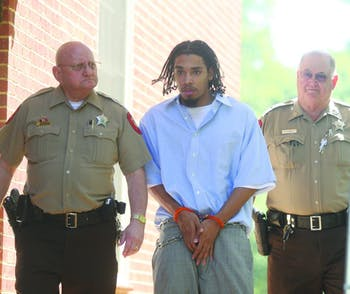 Demario Atwater is escorted to a 2008 Orange County court appearance. DTH File Photo