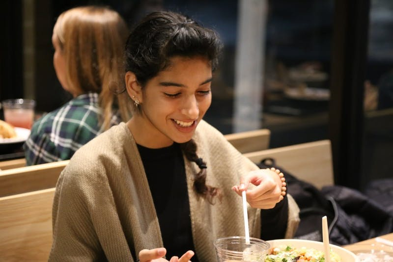 Senior, health policy and management major, Mali Khan at the Mediterranean chain restaurant Cava which recently opened in Chapel Hill on Nov. 13, 2018. Khan enjoyed her first time at Cava eating her fresh salad bowl but felt that the flavors were not particularly Mediterranean.
