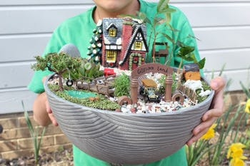 "Chapel Hill student Alex Shen holds his miniature garden ""GoShen Land"" that he created for the Community in Bloom contest. This contest encourages the community to get creative and find ""trash and treasures""  around their house to create their own miniature garden. This year's theme is ""Planting a Dream"" and the deadline to submit your entry is April 25. March 28, 2019. Chapel Hill."