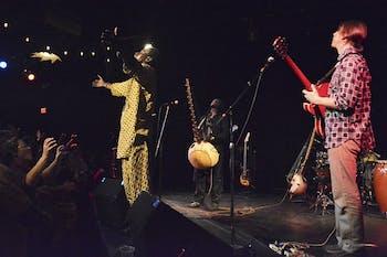 Mame Cheikh Nijigal Dieng dancing, John Westmoreland on electric guitar.