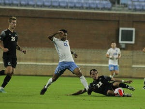 UNC junior midfielder Antonio Lopez (11) fights for the ball against a Wofford player during a home game on Oct. 12 at Dorrance Field.