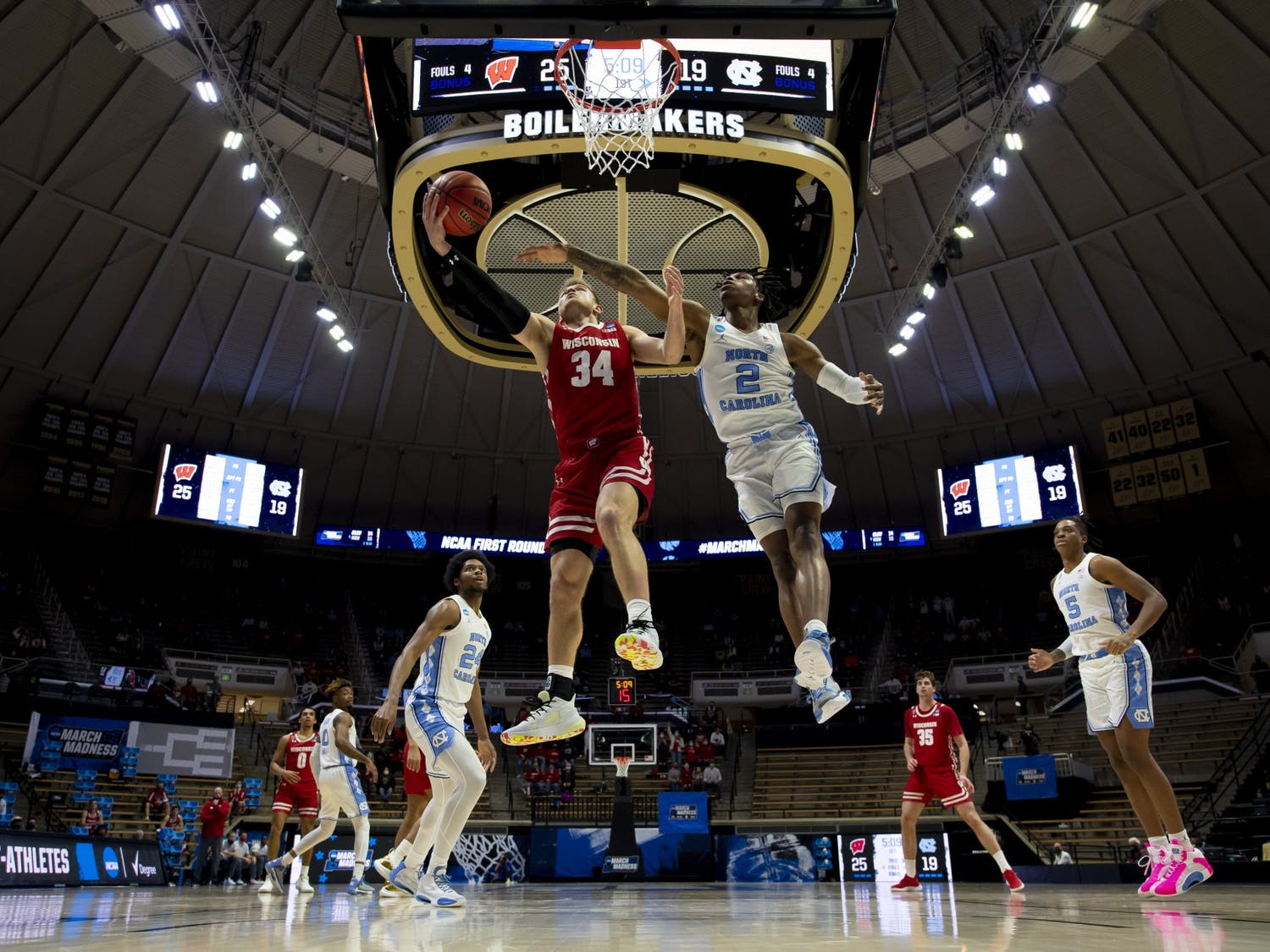 WEST LAFAYETTE, IN - MARCH 19: Brad Davison drives for a layup as Caleb Love of North Carolina defends in the first round of the 2021 NCAA Division I Men's Basketball Tournament held at Mackey Arena on March 19, 2021 in West Lafayette, Indiana. Photo by Andy Hancock/NCAA Photos/NCAA Photos via Getty Images