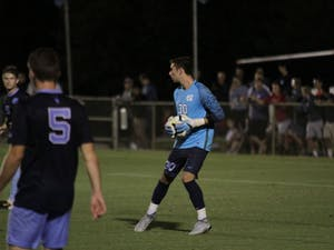 UNC goalie Alec Smir (30) plays in Friday's game against N.C. State at WakeMed Soccer Park in Cary.