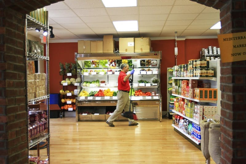 Mohamed Jamili tends to the newly opened Mediterranean Market located within Med Deli on West Franklin Street.