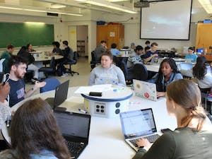 Students prepare for class in Phillips 208 on Monday, March 18, 2019.