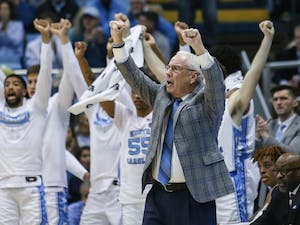 UNC's men's basketball coach Roy Williams cheers from the sidelines during a game against Boston College in the Smith Center on Saturday, Feb. 1, 2020. UNC fell to Boston College by just one point in the last minutes of the game, making the final score 71-70.