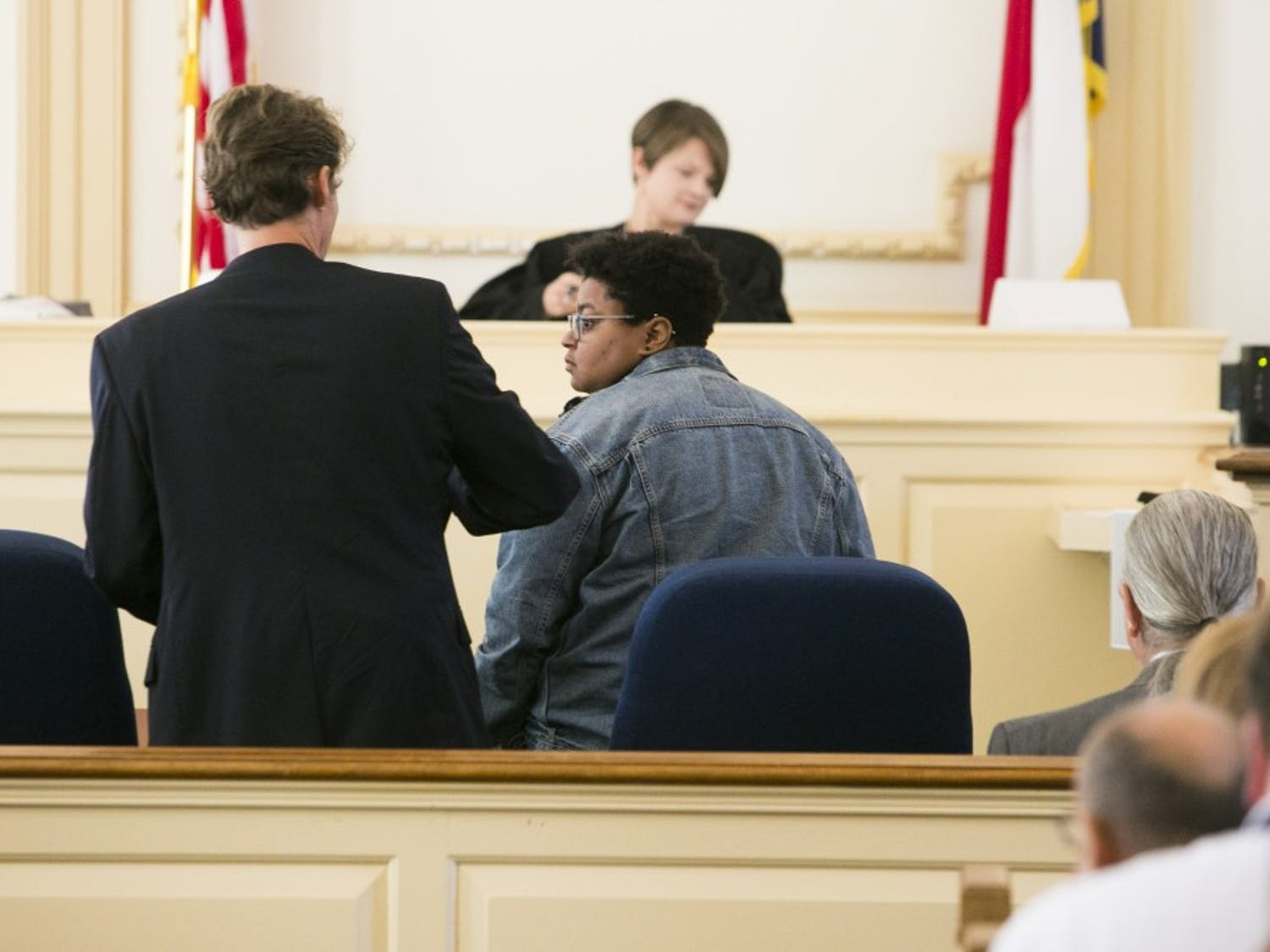 Maya Little and her lawyer prepare for the start of her hearing on Monday, Oct. 15, 2018, in Hillsboro N.C.