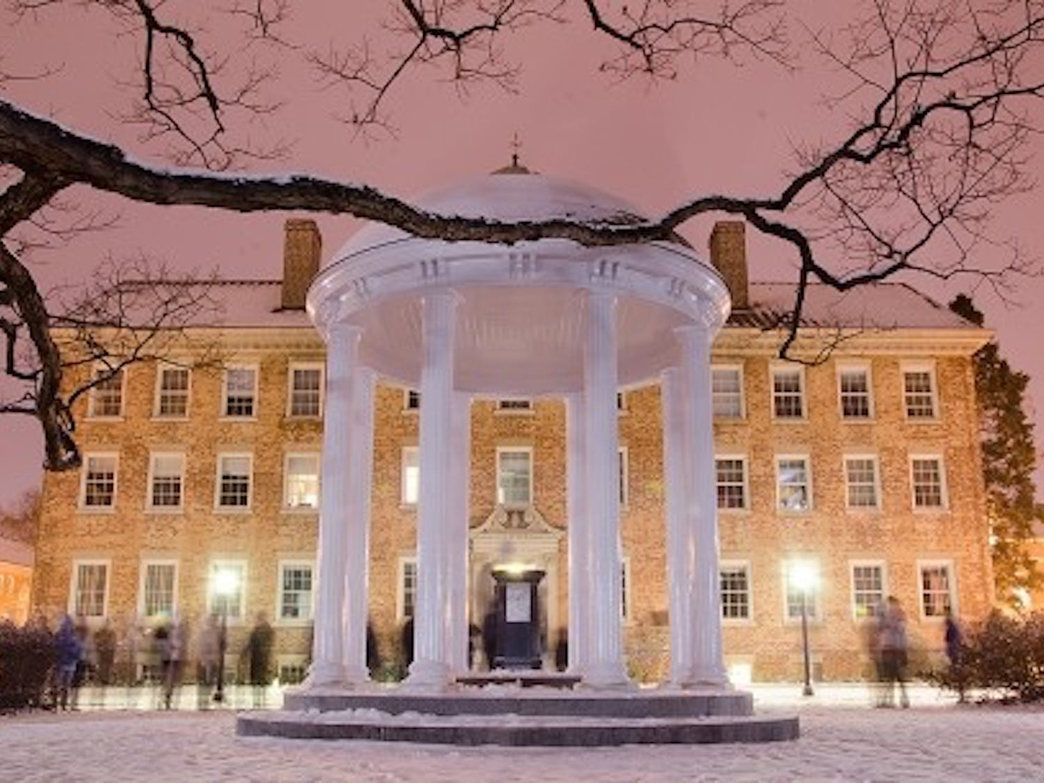 Students gather around the Old Well to enjoy the snow in January 2014.