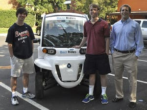 From left to right, co-founders of Buzz Rides Parker Draughon (President), a Business Administration and Romance Languages major from Atlanta, Ga., and Joey Skavroneck (CEO), a Business Administration major from Waxhaw, N.C., stand with Chris Jones (CFO), a Business Administration major from Charlotte, N.C.