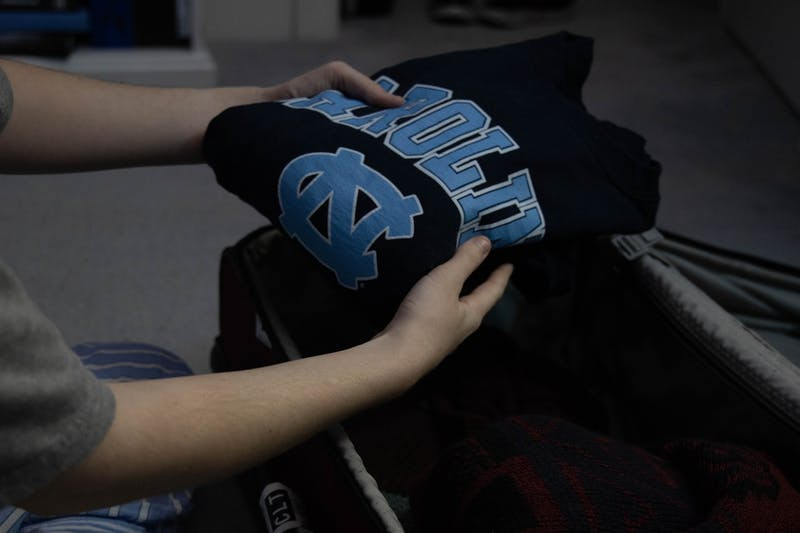 DTH Photo Illustration. The closing of UNC's residence halls for the rest of the year has left students scrambling to get their things from campus.