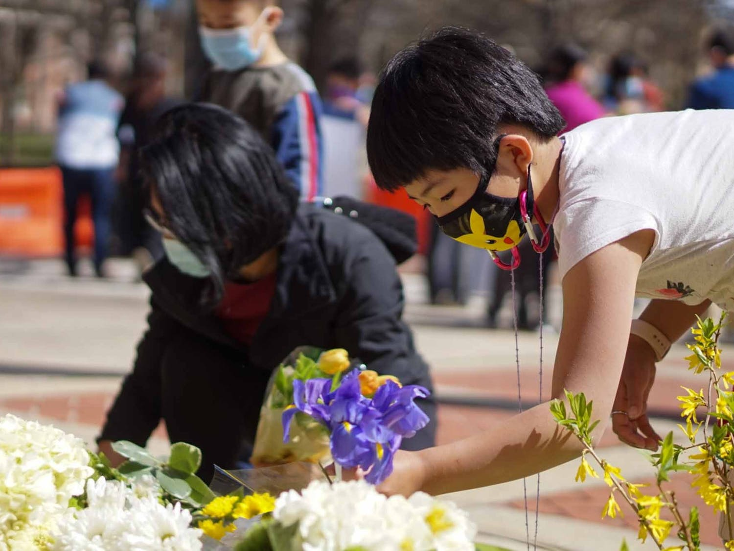 The Chinese American Friendship Association and North Carolina Asian Americans Together held a gathering of solidarity to honor and remember the victims of the Atlanta shootings outside of the Peace and Justice Plaza on Sunday, March 21, 2021.