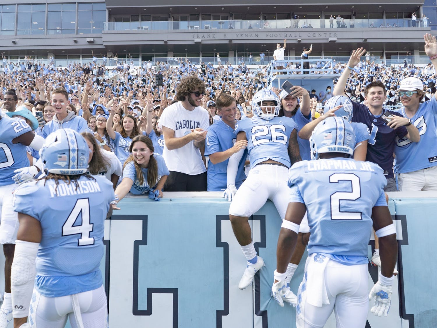 Fans meet and celebrate with UNC football players during the game against Duke in Kenan Memorial Stadium on Oct. 2, 2021.