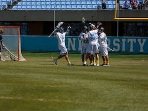 The North Carolina men's lacrosse team celebrates a goal against Notre Dame on April 21 at Kenan Stadium.