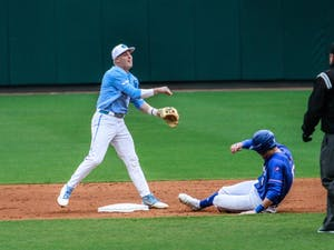 UNC second baseman junior Ike Freeman (8) throws the ball to first base against UMass Lowell on Sunday, March 3, 2019 at Boshamer Stadium.