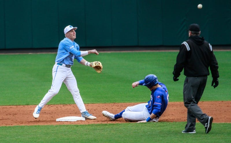 UNC second baseman junior Ike Freeman (8) throws the ball to first base against UMass Lowell on Sunday, March 3, 2019 at Boshamer Stadium.