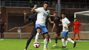 Forward Alex Rose (21) fights for the ball during the UNC men's soccer game against Campbell University on September 14, 2021. Carolina would walk away with a home field win that evening after scoring one goal in the second half.