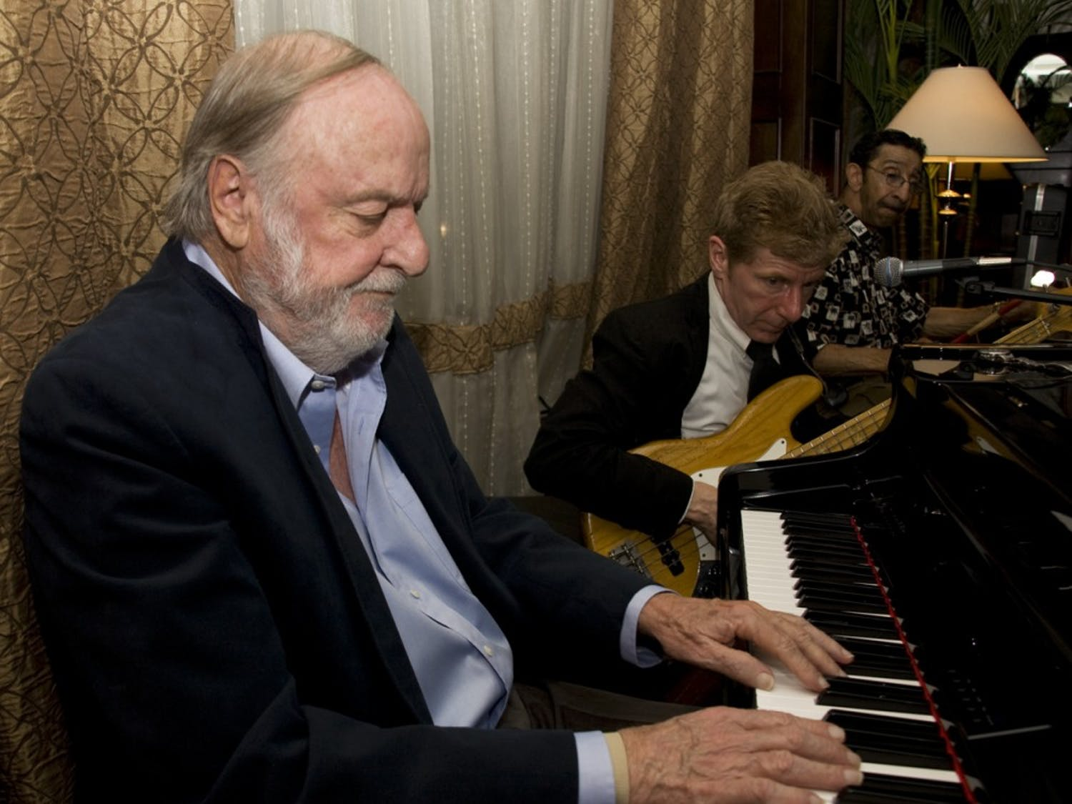 Pianist Jim Crisp plays with bassist Rick Keena and drummer Bubba Norwood at the Franklin Hotel. A resident of Chapel Hill since the 1960s, Crisp and his trio have been holding sway Wednesday at the Franklin for the past four years.