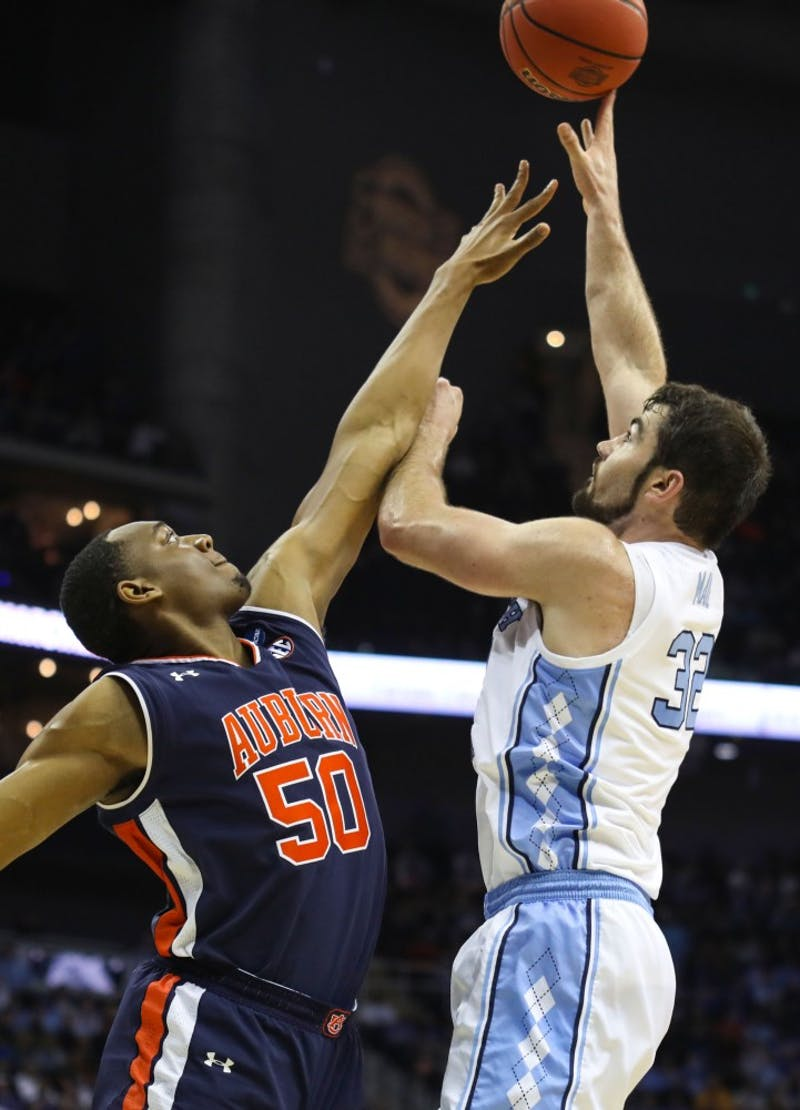Auburn junior center Austin Wiley (50) guards UNC senior forward Luke Maye (32) during UNC's 97-80 loss against Auburn in the Sweet 16 of the NCAA Tournament on Friday, March 29, 2019 at the Sprint Center in Kansas City, M.O.