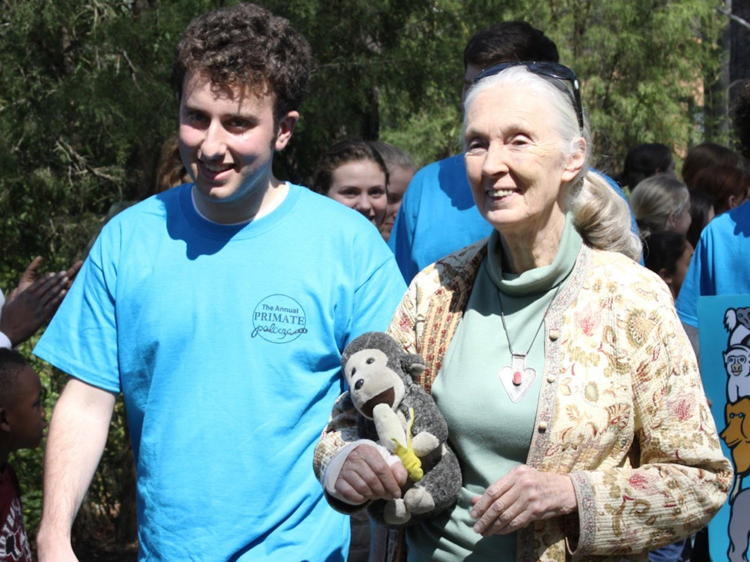 Jane Goodall leads the Primate Peace Parade with Aaron Sandel, a Duke student and one of the UNC/Duke Roots and Shoots founders.