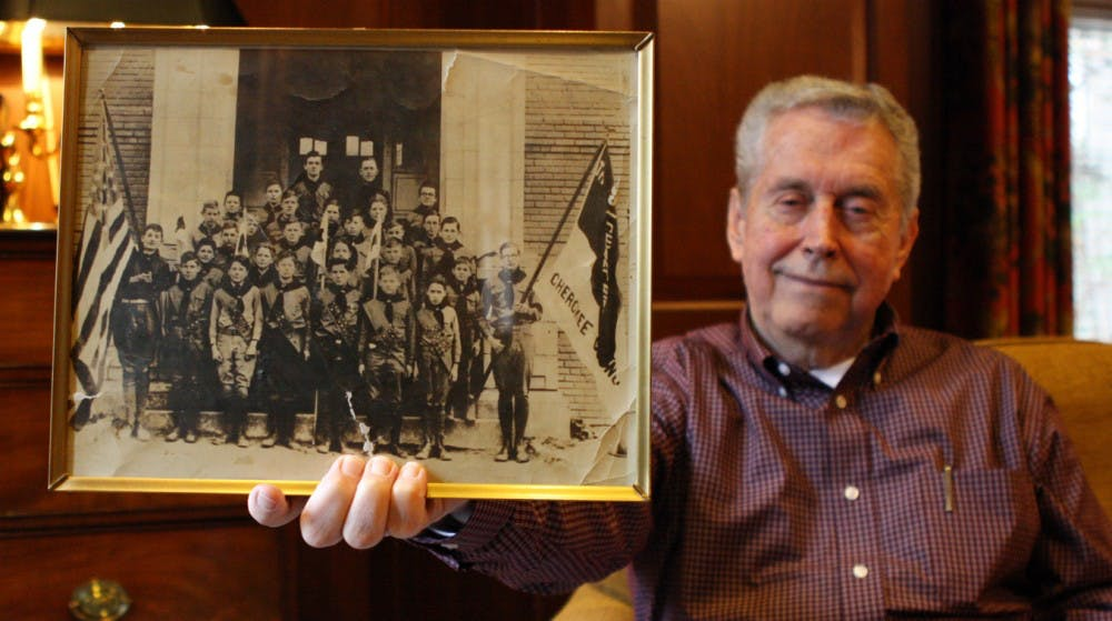 """James Mackorell, 78, UNC class of 1962, holds a picture of Troop 1, which eventually changed names to Troop 39.  Mackorell became a scout leader in 1964 and led the troop for 43 years.  """"Life is made up of making choices... What we tried to do was, like I said, build character in these boys that became men."""""""