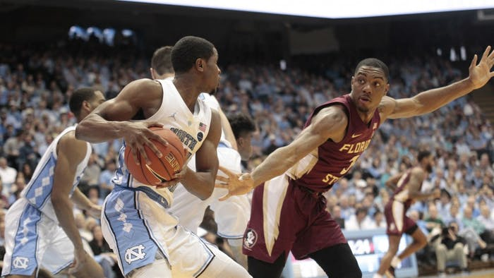 Senior guard Kenny Williams (24) holds the ball during UNC's 77-59 win over FSU at the Smith Center on Saturday, Feb. 23, 2019.