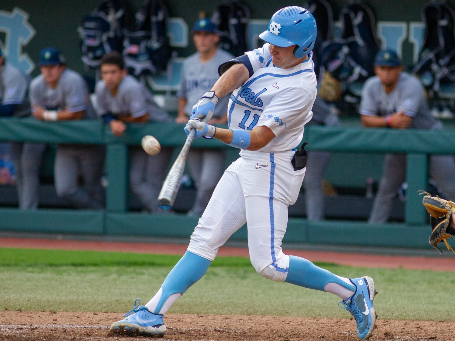 UNC sophomore outfielder Caleb Roberts (11) hits the ball at the game against UNCW on Tuesday May 18, 2021 at Boshamer stadium. The Tar Heels won 14-9.