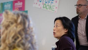 """Chapel Hill council member Hongbin Gu asks a question of Tim O'Brien (not pictured) during a Bloomberg 2020 """"strategy session"""" at the campaign's Chapel Hill office on Tuesday, Jan. 21, 2020."""