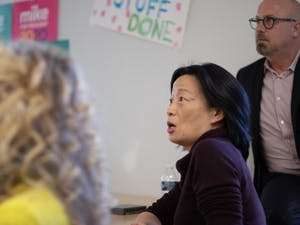 "Chapel Hill council member Hongbin Gu asks a question of Tim O'Brien (not pictured) during a Bloomberg 2020 ""strategy session"" at the campaign's Chapel Hill office on Tuesday, Jan. 21, 2020."