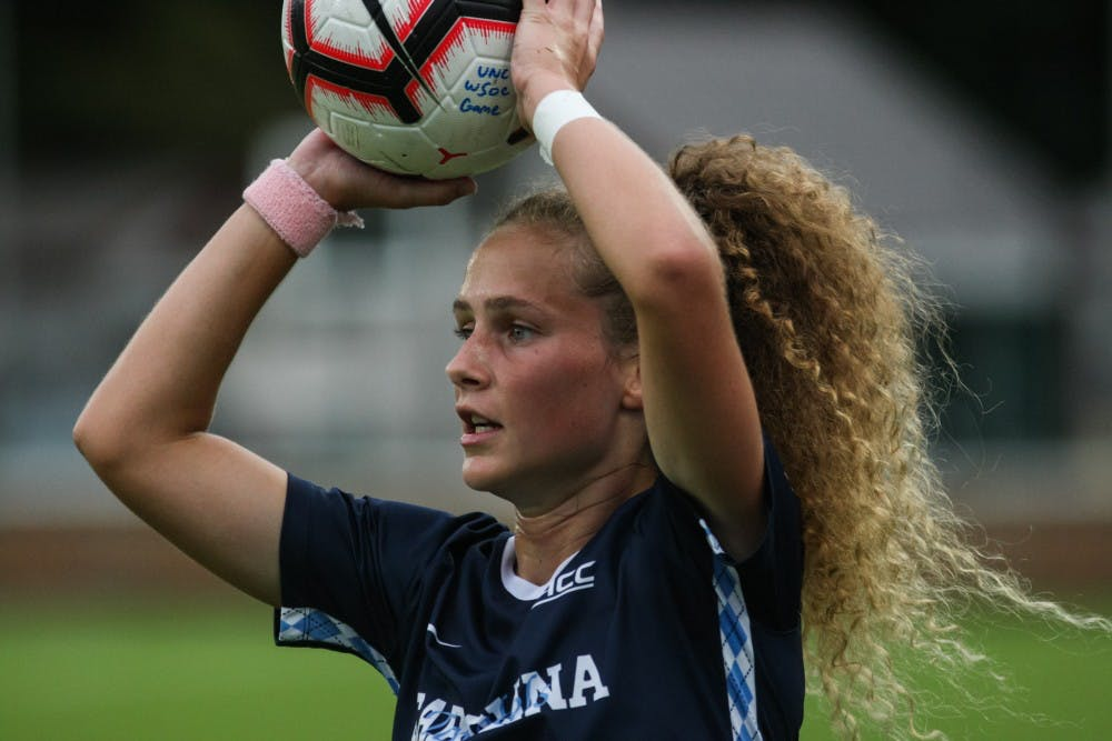 <p>Number 27, junior defender Lois Joel, prepares to throw the ball back into play during a game against Clemson on &nbsp;Saturday, Oct. 5th, 2019. UNC beat Clemson 1-0.</p>