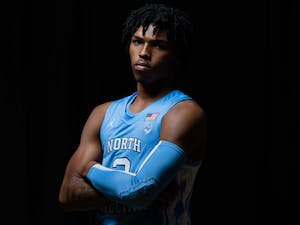 UNC first year guard Caleb Love poses for a portrait in the Smith Center on Wednesday, October 7, 2020. Photo courtesy of Morgan Pirozzi for UNC Athletic Communications.