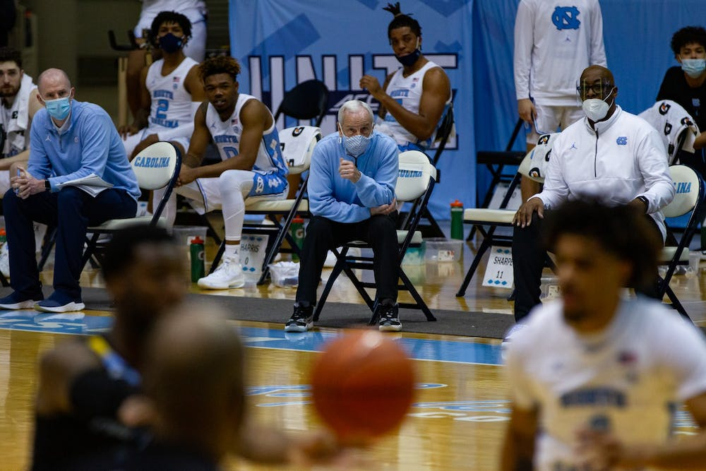 <p>UNC men's basketball coach Roy Williams watches on as UNC faces off against Marquette in the Smith Center on Wednesday, Feb. 24, 2021. UNC lost to Marquette 83-70.&nbsp;</p>