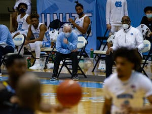 UNC men's basketball coach Roy Williams watches on as UNC faces off against Marquette in the Smith Center on Wednesday, Feb. 24, 2021. UNC lost to Marquette 83-70.