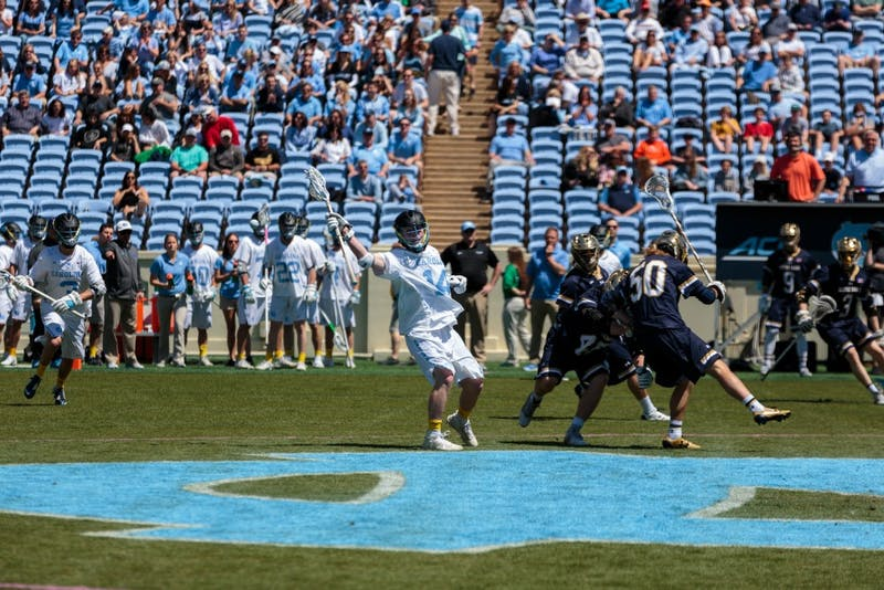 UNC's William McBride (14) calls for the ball against Notre Dame on April 20 at Kenan Stadium.