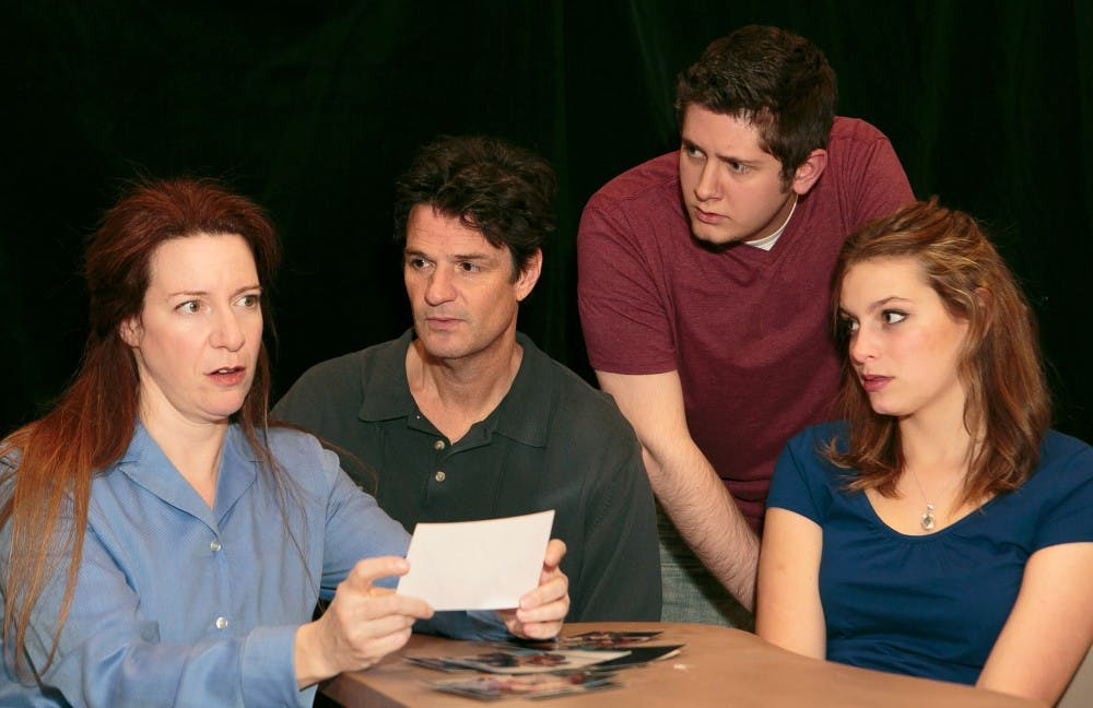 """<p>Lisa Jolley, John Allore, Wesley Miller and Abigail Coryell (left to right) rehearse for Deep Dish Theater Company's production of """"Next to Normal"""" opening tonight in University Mall. </p>"""
