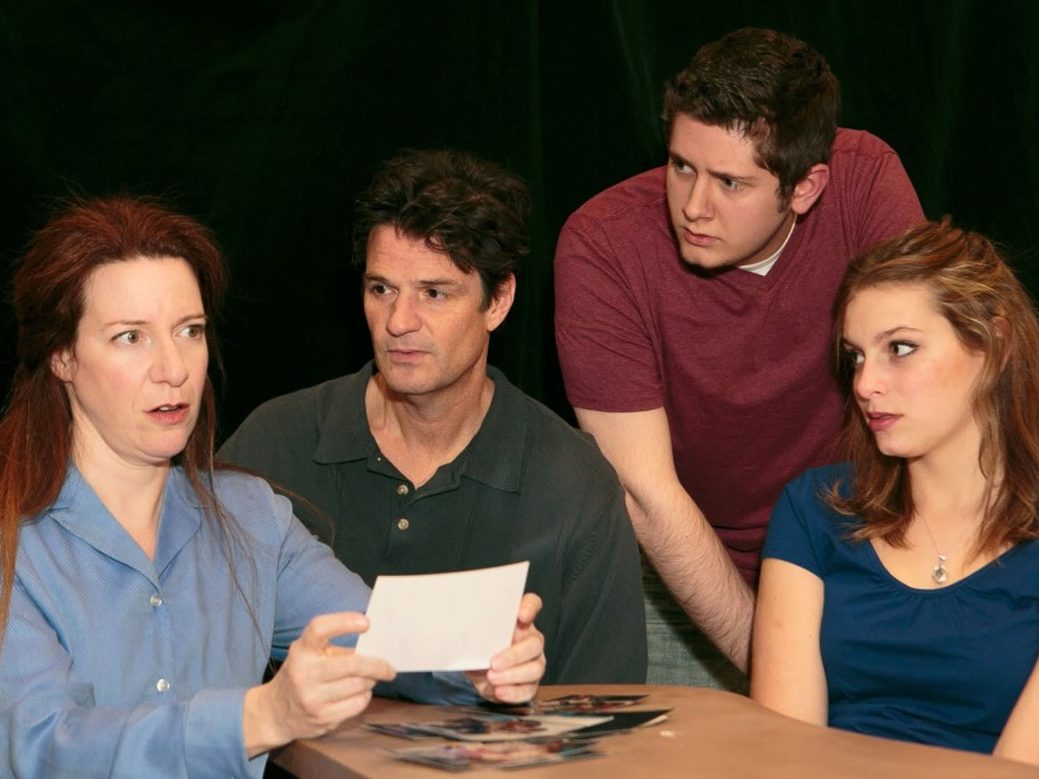 """Lisa Jolley, John Allore, Wesley Miller and Abigail Coryell (left to right) rehearse for Deep Dish Theater Company's production of """"Next to Normal"""" opening tonight in University Mall."""