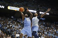 Seventh Woods goes up against Joel Berry during a scrimmage at Late Night With Roy on Friday night.