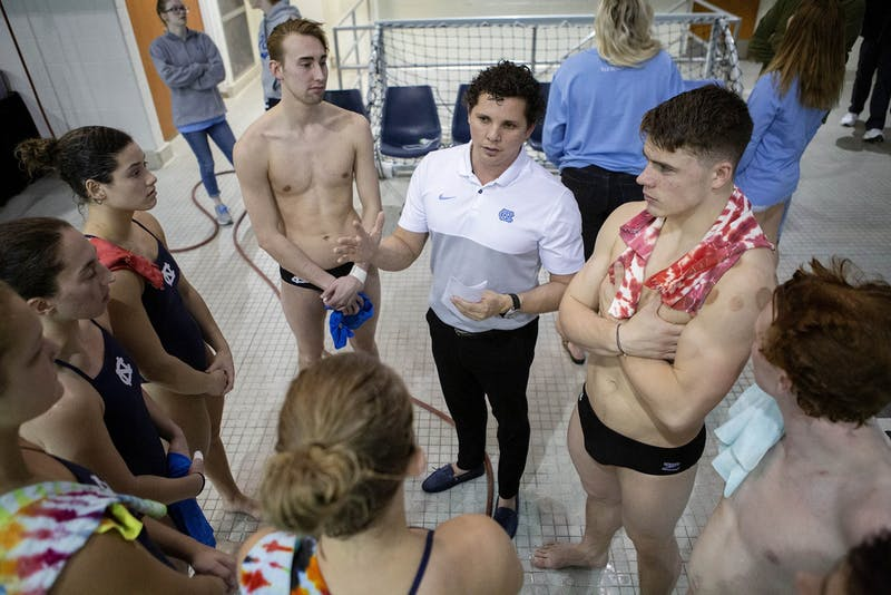 UNC head diving coach Yaidel Gamboa talks to athletes before a game against NC State at Koury Natatorium on Friday, Jan. 17, 2020. Photo courtesy of Barron Northrup.