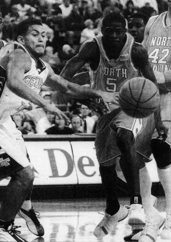 UNC's Jackie Manuel races for the ball against Georgia Tech's Tony Akins. Manuel scored four points in 19 minutes in the Tar Heels' 86-74 loss. Image from the DTH archive on Monday, Feb. 4, 2020.