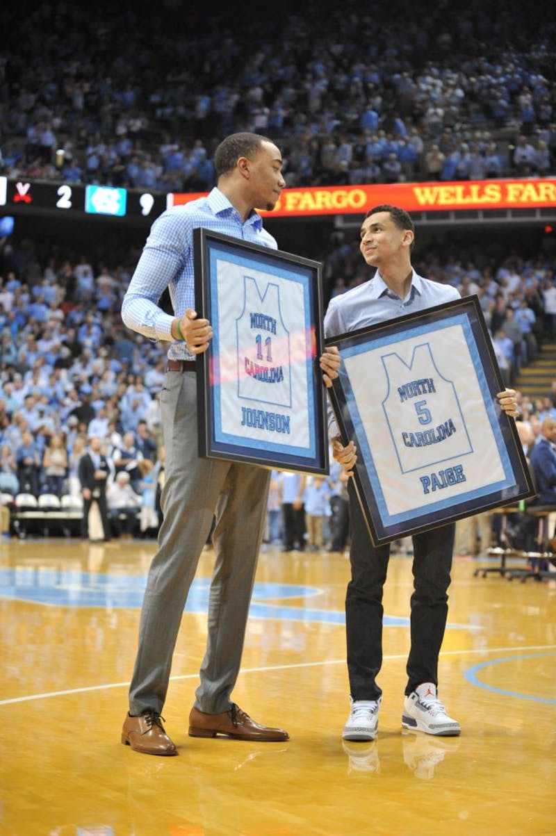 The North Carolina men's basketball team defeated Virginia 65-41 in Chapel Hill Saturday night. Former teammates Brice Johnson and Marcus Paige were honored at halftime.