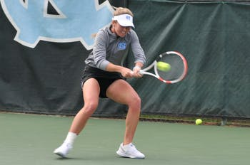UNC senior Makenna Jones returns the ball against her opponent on Friday, Feb. 28, 2020 at the Cone-Kenfield Tennis Center. Jones won her set against Virginia. UNC defeated Virginia 6-1.